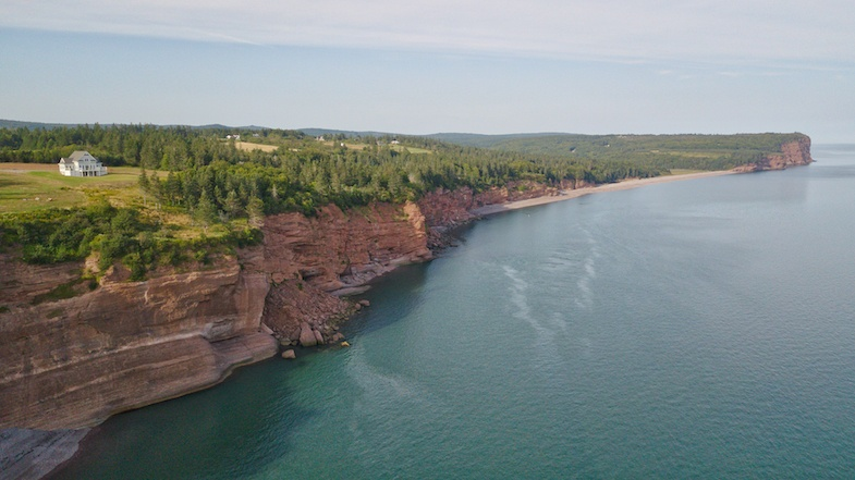 Bay of Fundy cliff is one of the many scenic roads in Canada - aerial shot by MikesRoadTrip.com
