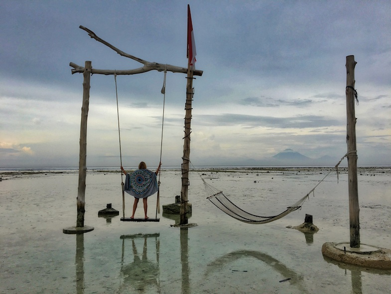 travel in your 20s to Gili Trawangan and swing in the water