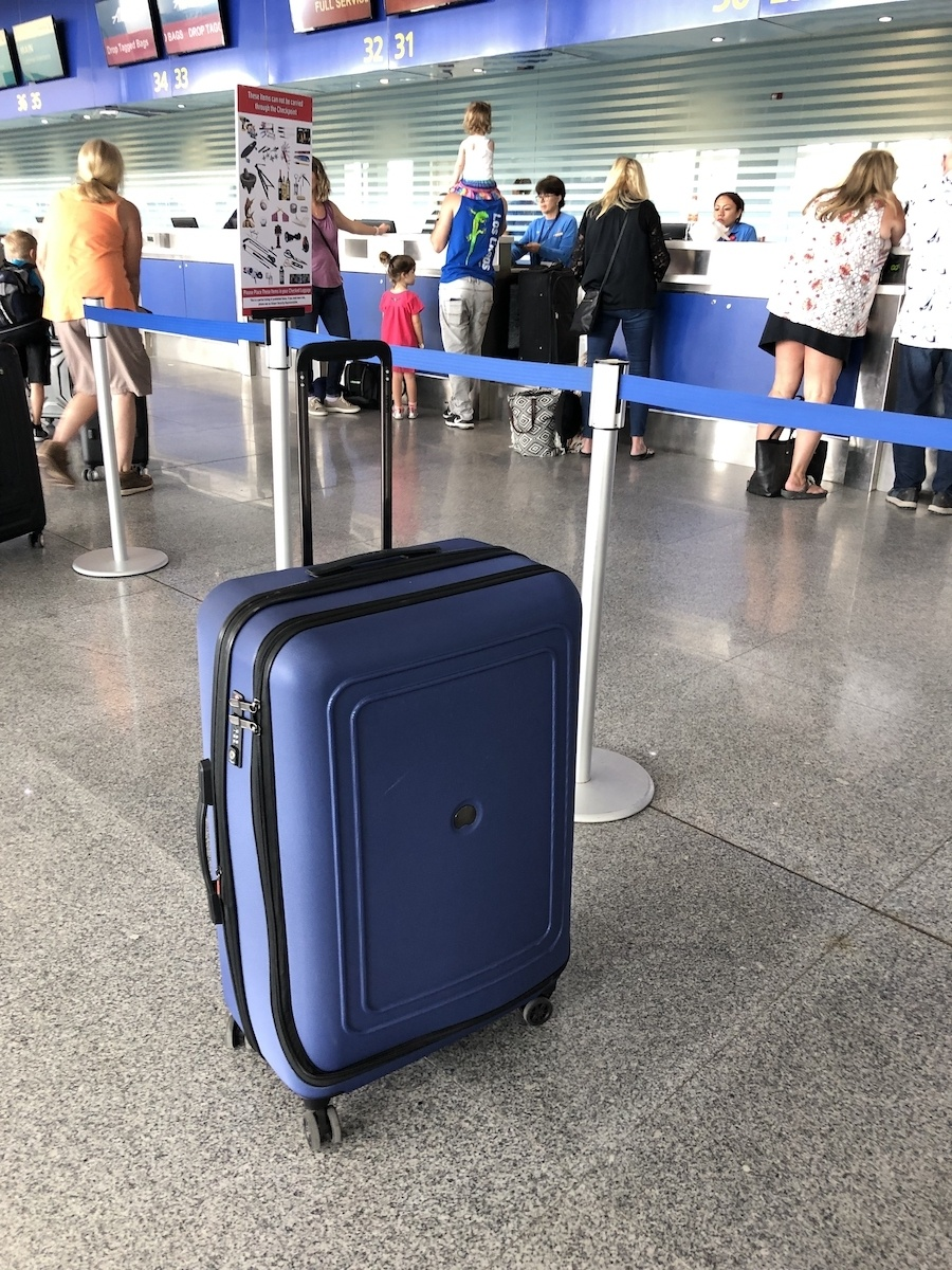 Delsey CRUISE LITE HARDSIDE luggage at airport by MikesRoadtrip.com