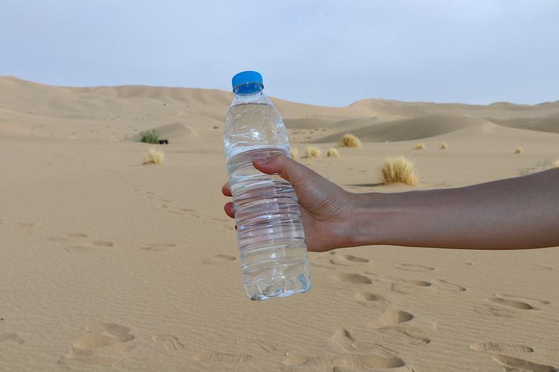 Bottle of water in the Gobi Desert by MikesRoadTrip.com