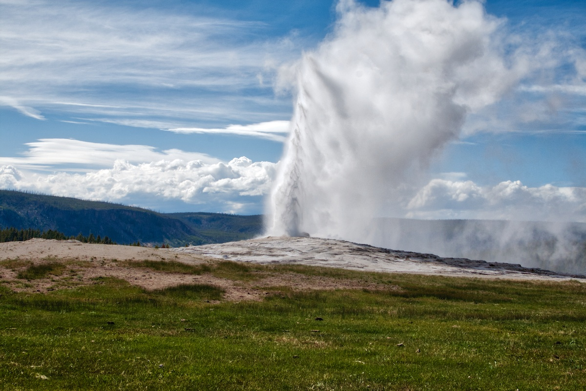Visit Yellowstone National park in Wyoming and see Old Faithful Geyser. Photo by: Mike Shubic