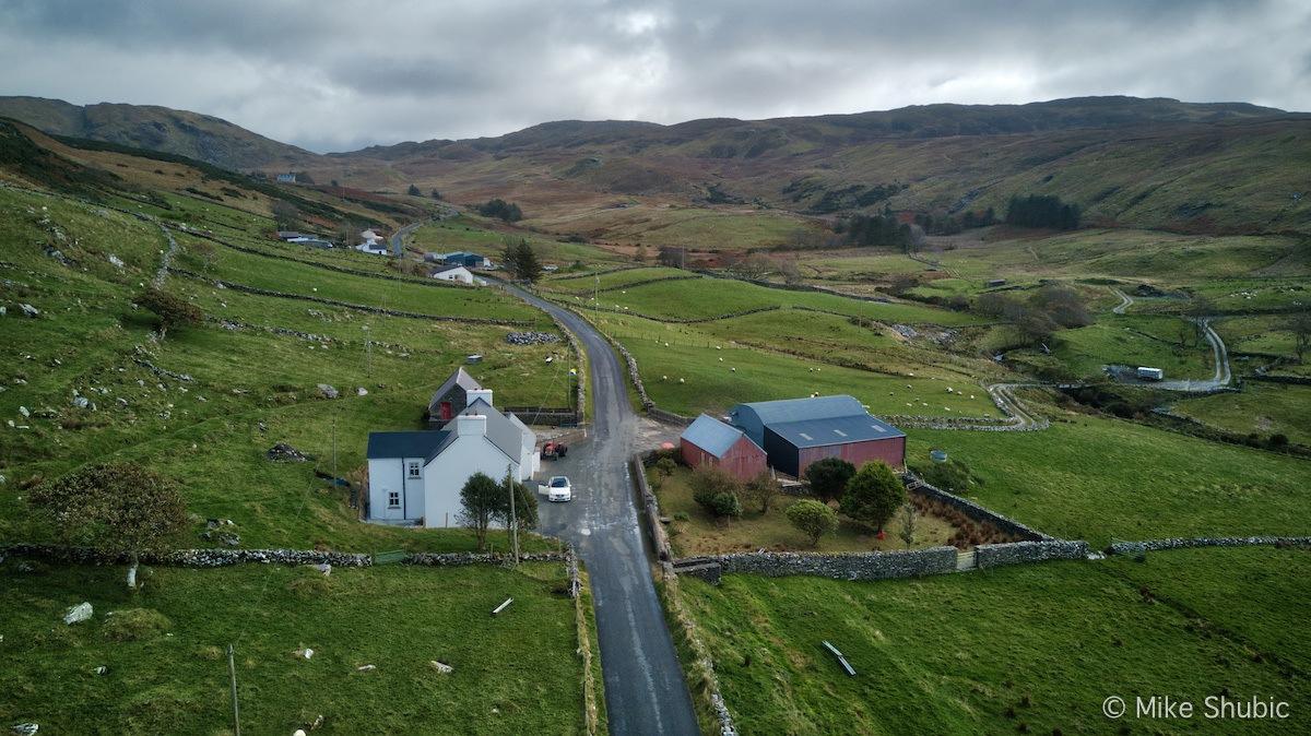Road running through a farm by MikesRoadTrip.com