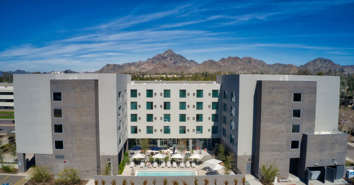 AC Hotel Phoenix with Camelback Mt. in background by MikesRoadTrip.com