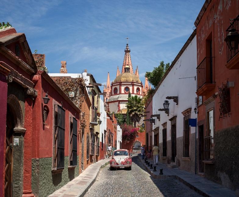 Cathedral of San Miguel de Allende in Mexico Behind Colorful Mexican Buildings