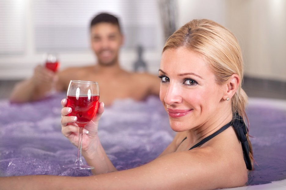 Couple having cocktails in hot tub in Jamaica