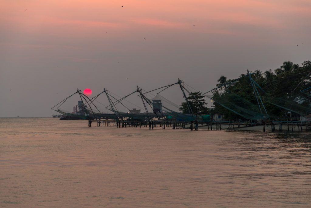 Fishing nets at sunset in Kochi