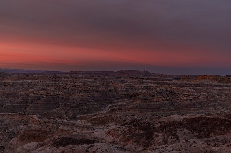 Badlands in New Mexico at sunset by Mihaela of WorldTravelBug.com